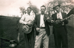 Fiddler Clay Reed and sons Howard (guitar) and Ray (mandolin). Laurel  Springs, North Carolina, 1949. (Collection: Marshall Wyatt)